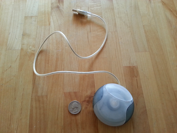 I detested the hockey puck mouse so much that I actually kept one as a reminder. My original iMacs are all gone, but the mouse remains! (Image from Gookin, not stolen from WikiMedia.)
