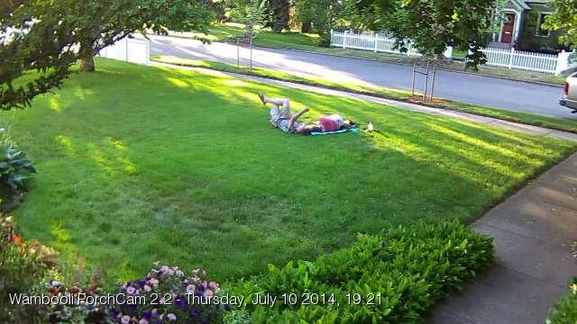 July 10. My son and his girlfriend enjoying my freshly-mowed lawn.